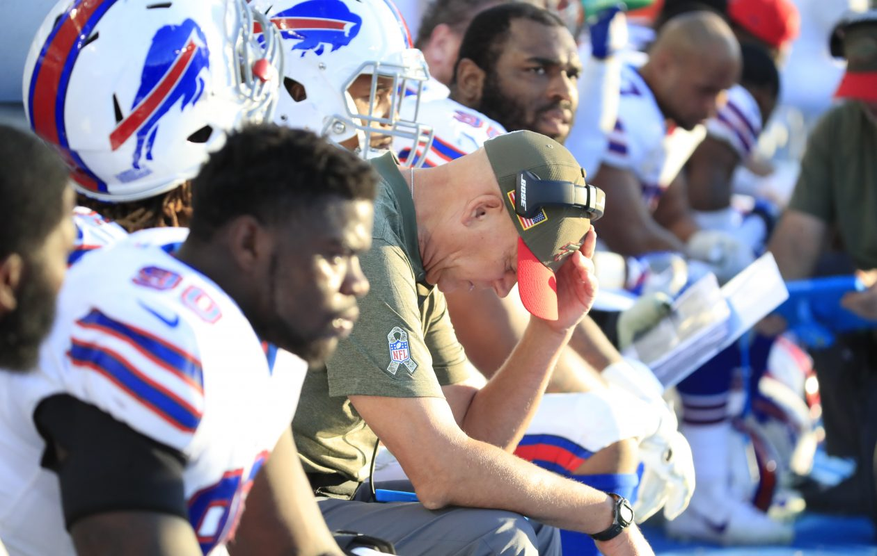 Buffalo Bills assistant coach Mike Waufle sits on the bench and looks at a notepad during the fourth quarter of the Bills' loss in Los Angeles. (Harry Scull Jr./ Buffalo News)