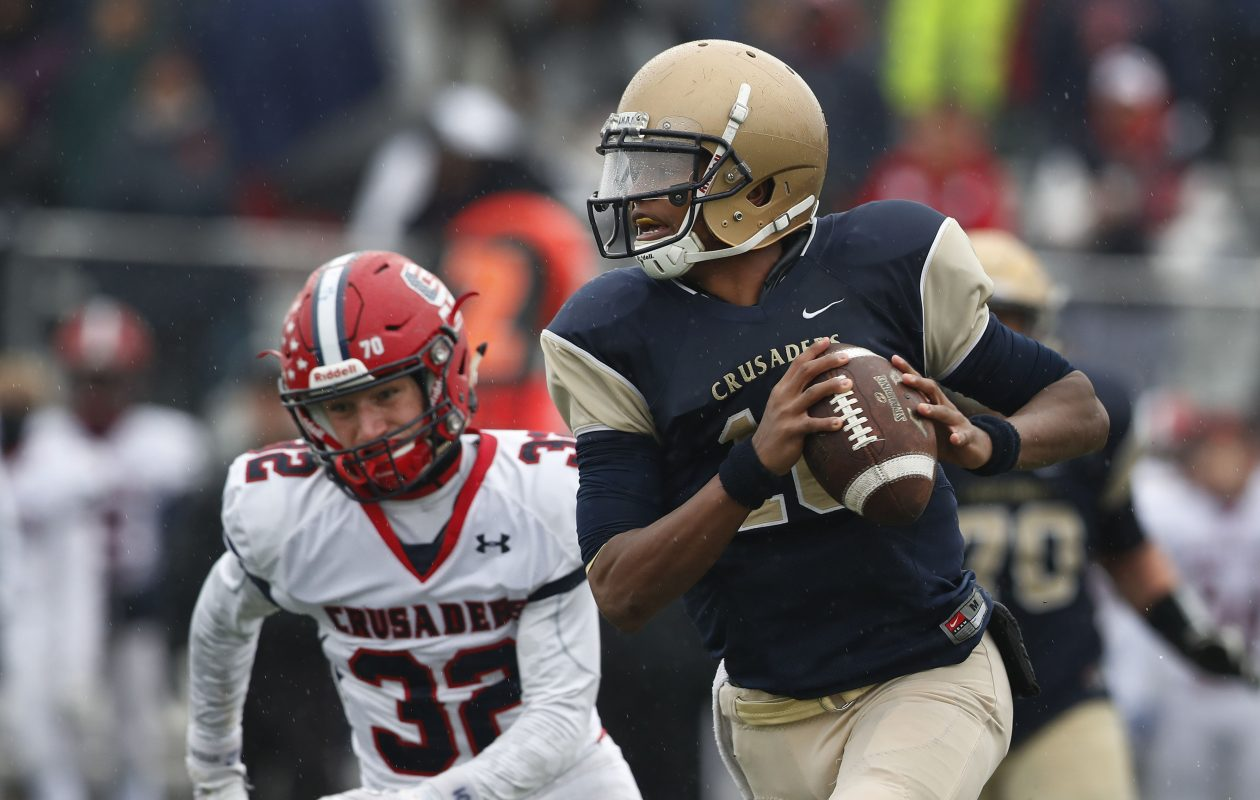 Jayce Johnson scrambles from a defender in Canisius' 49-28 loss to Archbishop Stepinac in the NYSCHSAA championship game at the Stransky Complex on Saturday. The quarterback accounted for all four of his team's touchdowns, two rushing and two passing. (Mark Mulville/Buffalo News)