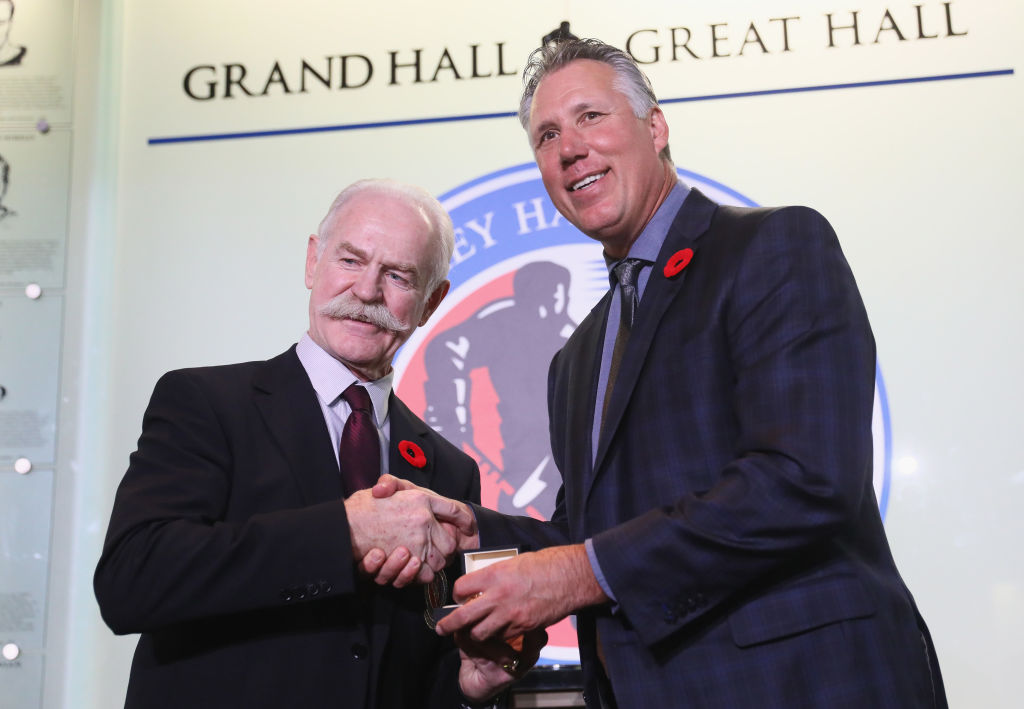 Dave Andreychuk accepts his ring from Hall of Fame chair Lanny McDonald Friday in Toronto (Getty Images).