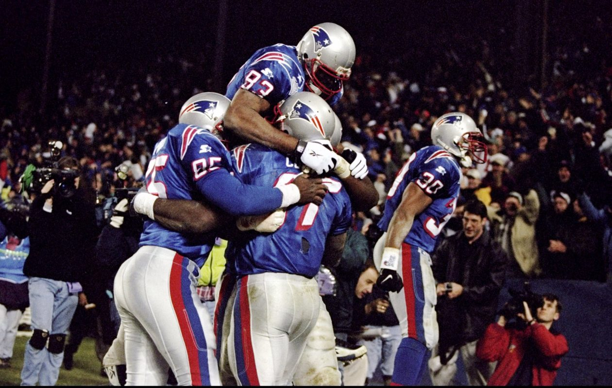 Tight end Ben Coates (87) of the New England Patriots is mobbed by teammates after a touchdown during a game against the Buffalo Bills at Foxboro Stadium in Foxboro, Mass., on Nov. 29, 1998. The Patriots defeated the Bills 25-21. (Al Bello/Allsport-Getty Images)