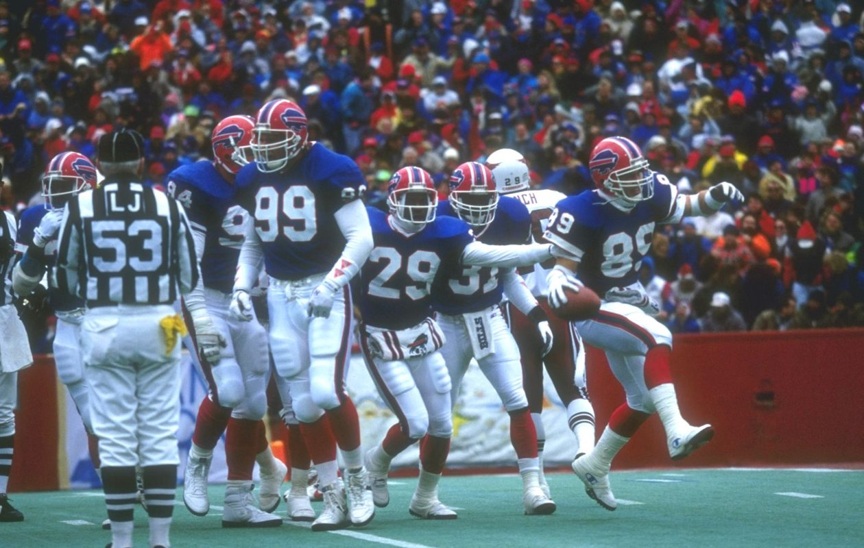 Members of the Bills celebrate on the field at Rich Stadium during Buffalos game against the Cardinals on Nov. 11, 1990. (Getty Images)