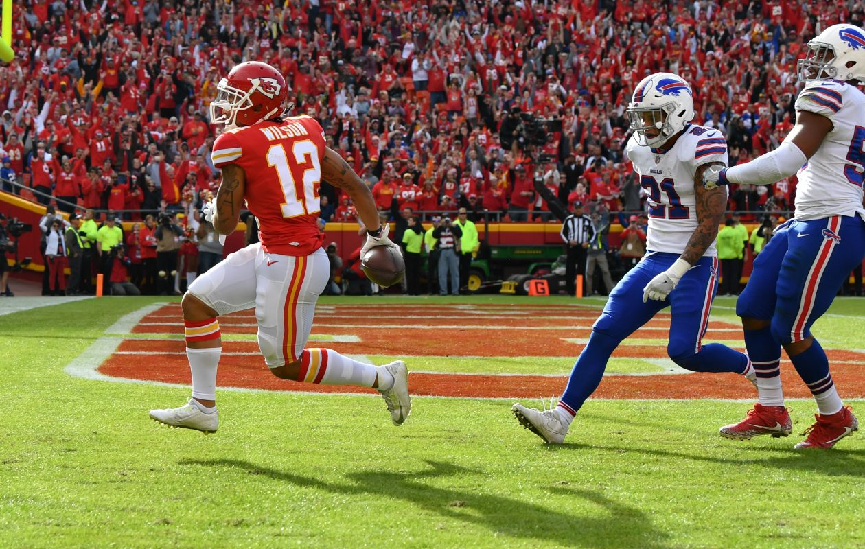 Wide receiver Albert Wilson #12 of the Kansas City Chiefs takes a pass in for a touchdown in front of Jordan Poyer #21 and middle linebacker Preston Brown #52 of the Buffalo Bills at Arrowhead Stadium on Nov. 26, 2017, in Kansas City, Mo. (Peter Aiken/Getty Images)