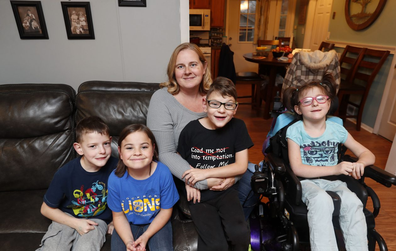 Bridgett Maskell with her children, from left, Tyler Mistalski, Ramona Maskell, Justin Mistalski, and Anna Belle Maskell, at their home in Lockport, N.Y. on Thursday, Nov. 9, 2017.  Missing were Aimee Joe Maskell and Brandon Pardee.  (Mark Mulville/Buffalo News)