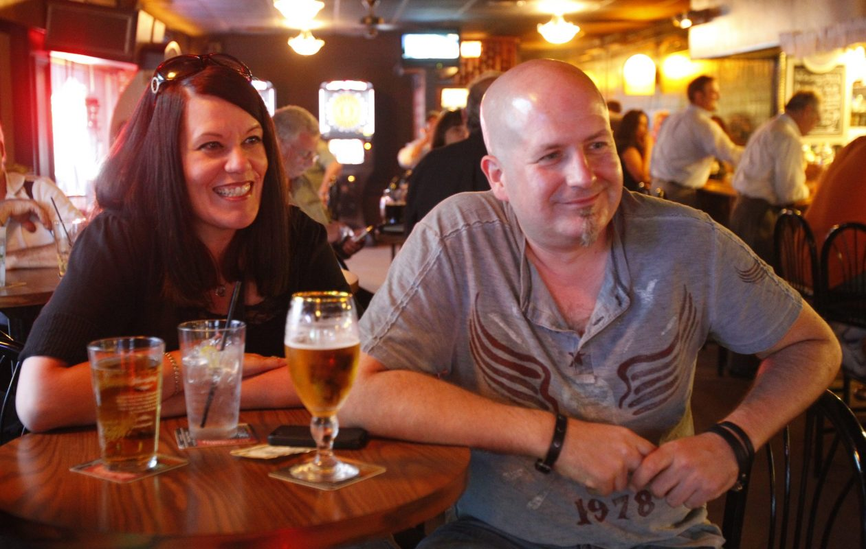 Kelly and Jay Medynski listen to the Big Sauce Trio performing at Alternative Brews in 2013. (Harry Scull Jr./News file photo)