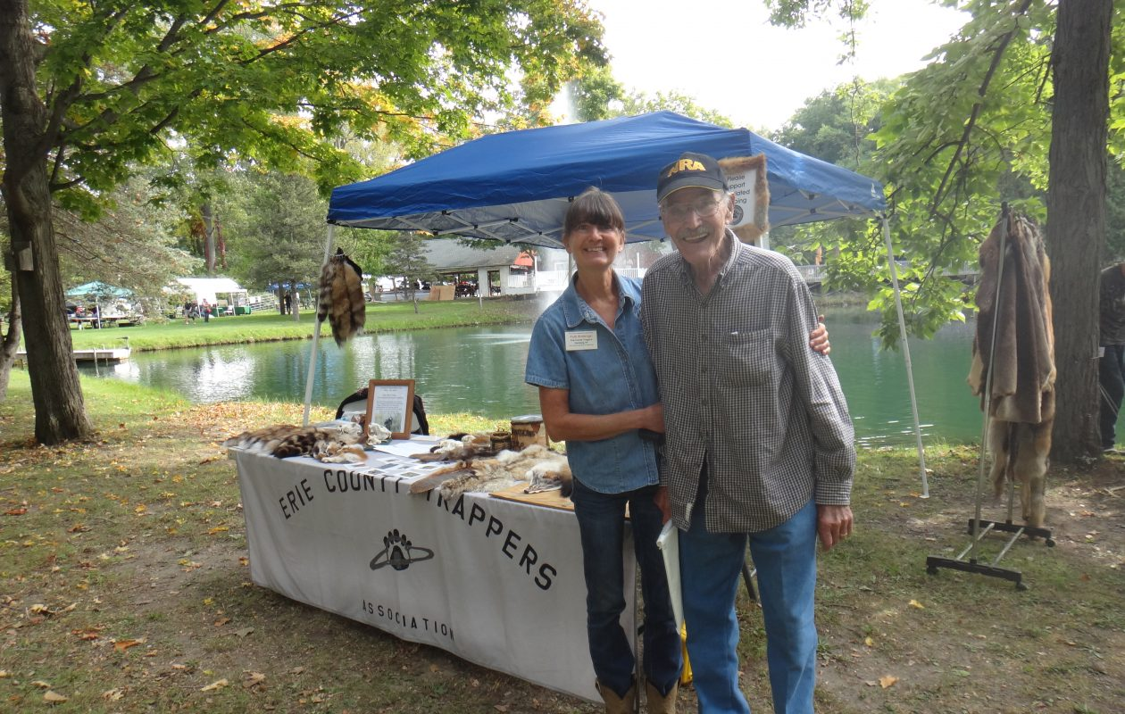 Al Reigle with Patti Wattengel in the Erie County Trappers booth during National Hunting and Fishing Day