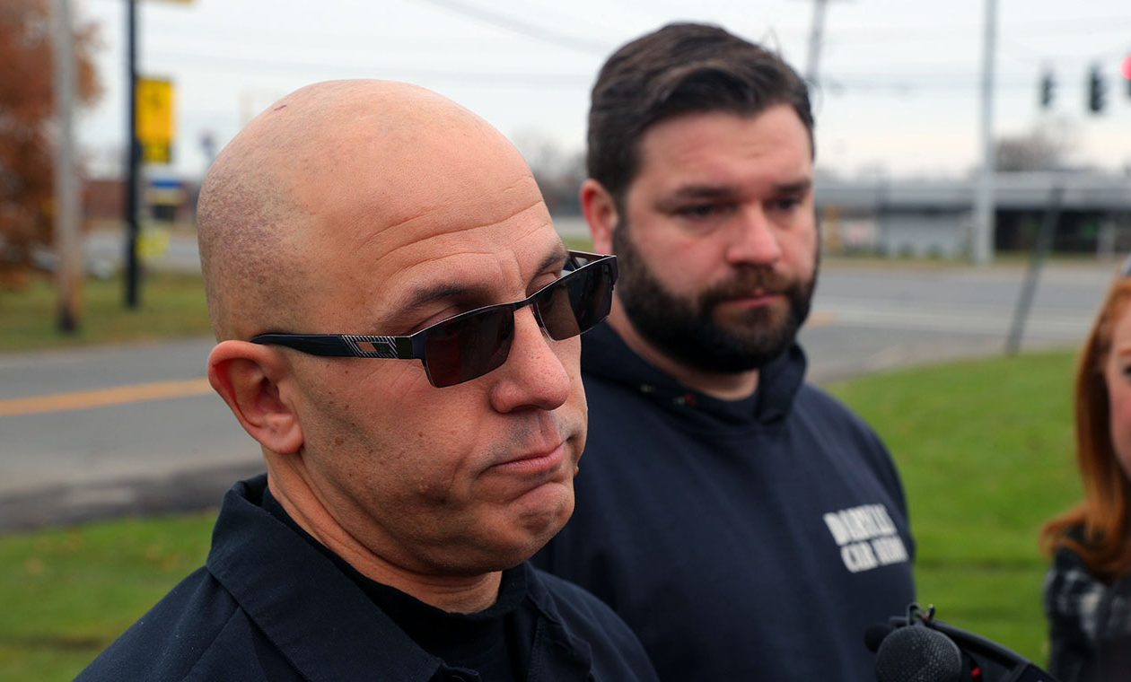 Mark Pinnavaia, left, Chris Kaufmann, the owner and the manager at Daryl's Car Audio, talk about how they helped stop Travis Green from firing shots the day before outside a Dollar General store off Union Road in the Town of Cheektowaga. (John Hickey/Buffalo News)