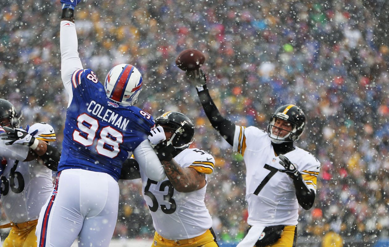 Defensive tackle Deandre Coleman, back for another stint with the Bills, gets a hand up in front of Steelers quarterback Ben Roethlisberger. (Getty Images)