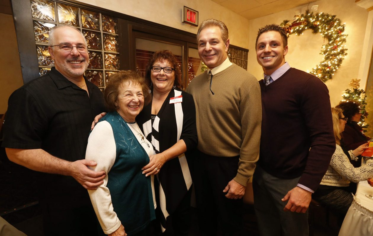 Dennis DiPaolo, second from right, with his family, including, from left, brother Michael DiPaolo, mother Ethel, sister Barbara Hunt,  and Dennis' son Ilio, Jr.,  at Ilio DiPaolo's Restaurant's 50th anniversary. (Robert Kirkham/Buffalo News)
