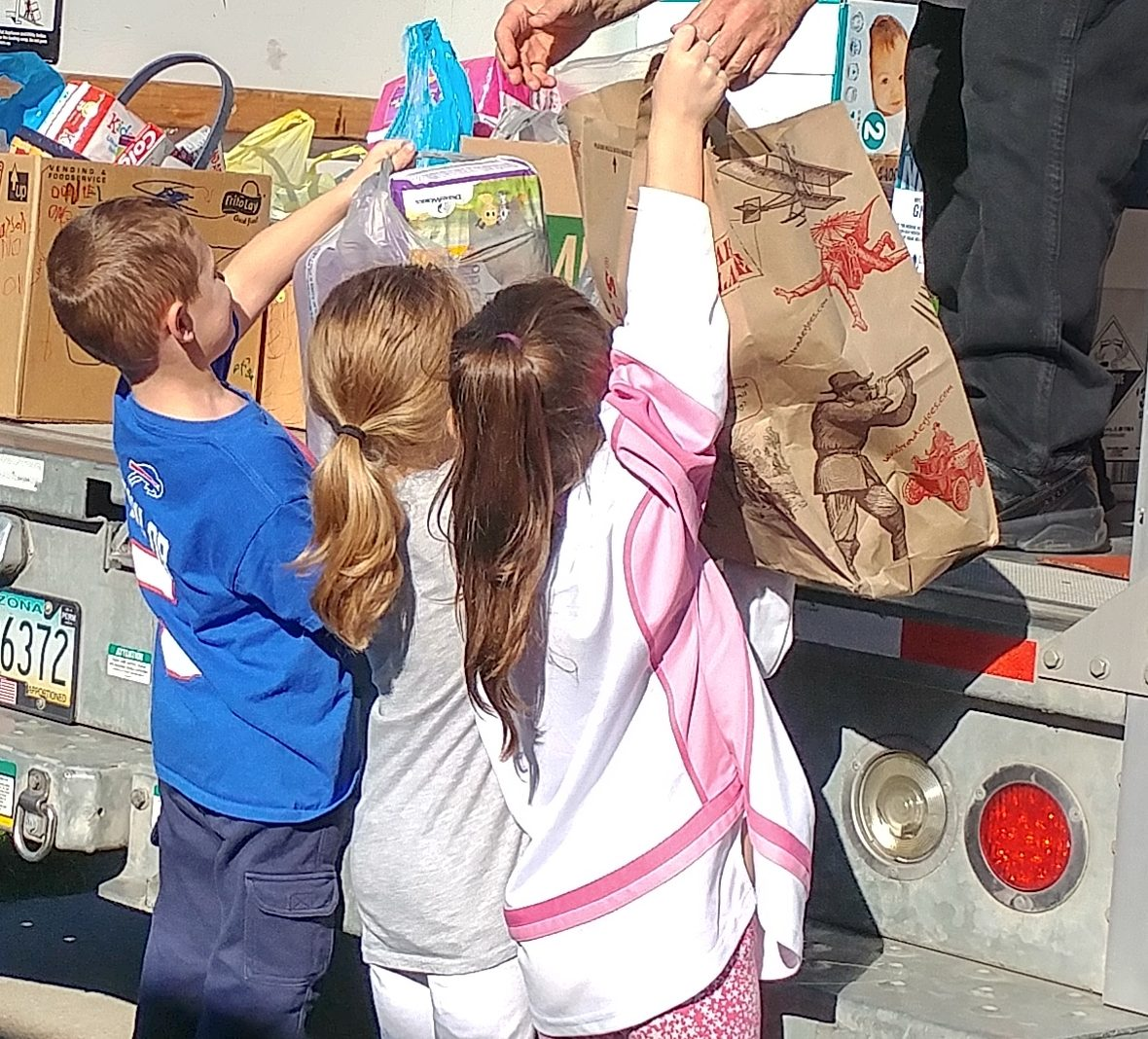 Kindergarteners at Allendale Elementary in West Seneca were happy to help pack up the U-Haul with donations. (Photo courtesy of West Seneca Central School District)