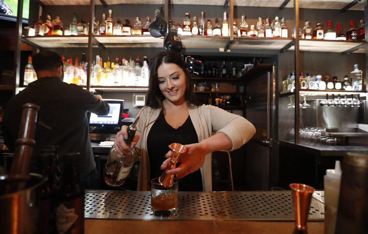 Forty Thieves bartender Genevieve Coughlin mixes up a drink called The Butcher at Forty Thieves.   (Mark Mulville/Buffalo News)
