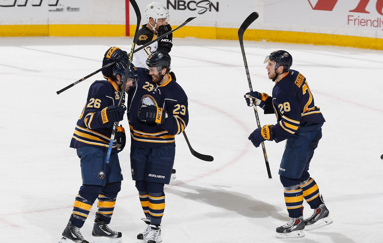 Sabres forward Zemgus Girgensons saw an extremely rare celebration by Matt Moulson (26) and Ville Leino (23) in February 2014. (Getty Images)