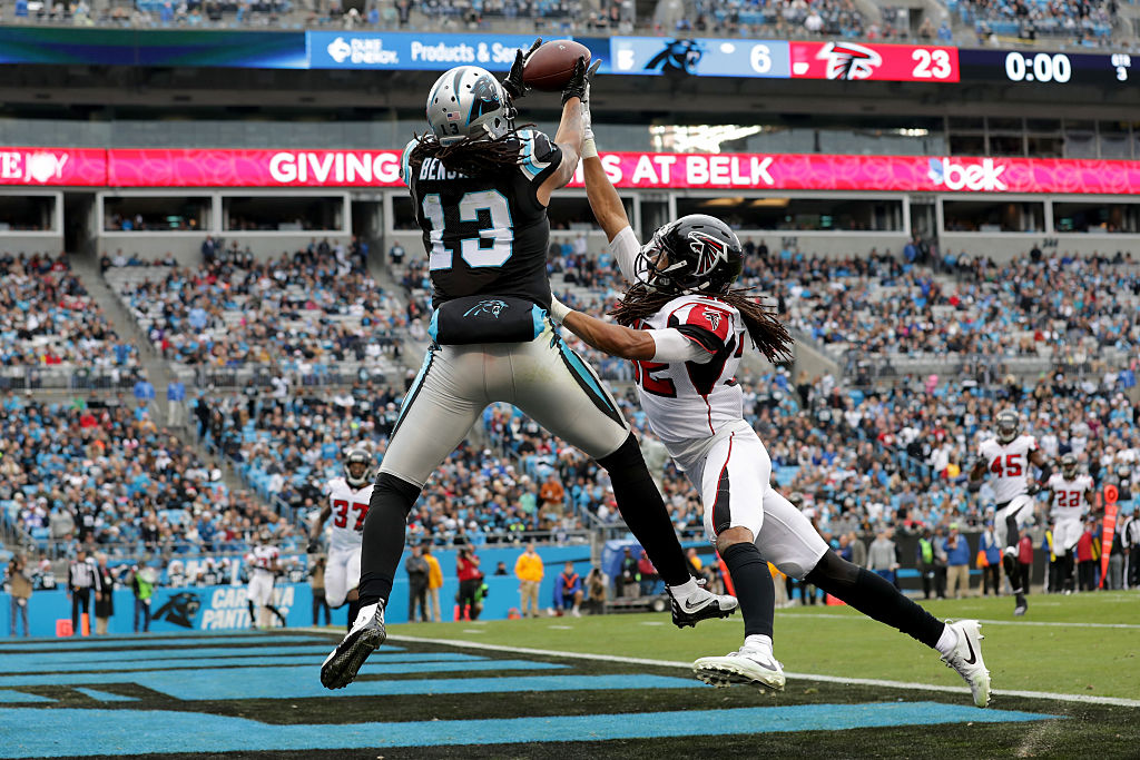 Kelvin Benjamin #13 of the Carolina Panthers catches a touchdown against  Jalen Collins #32 of the Atlanta Falcons in the 3rd quarter during their game at Bank of America Stadium on December 24, 2016 in Charlotte, North Carolina.  (Photo by Streeter Lecka/Getty Images)