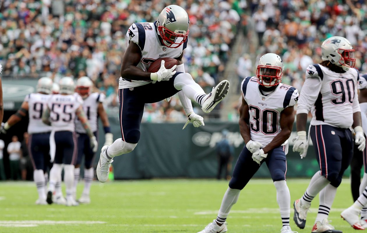 Devin McCourty of the New England Patriots celebrates after intercepting a pass  (Abbie Parr/Getty Images)