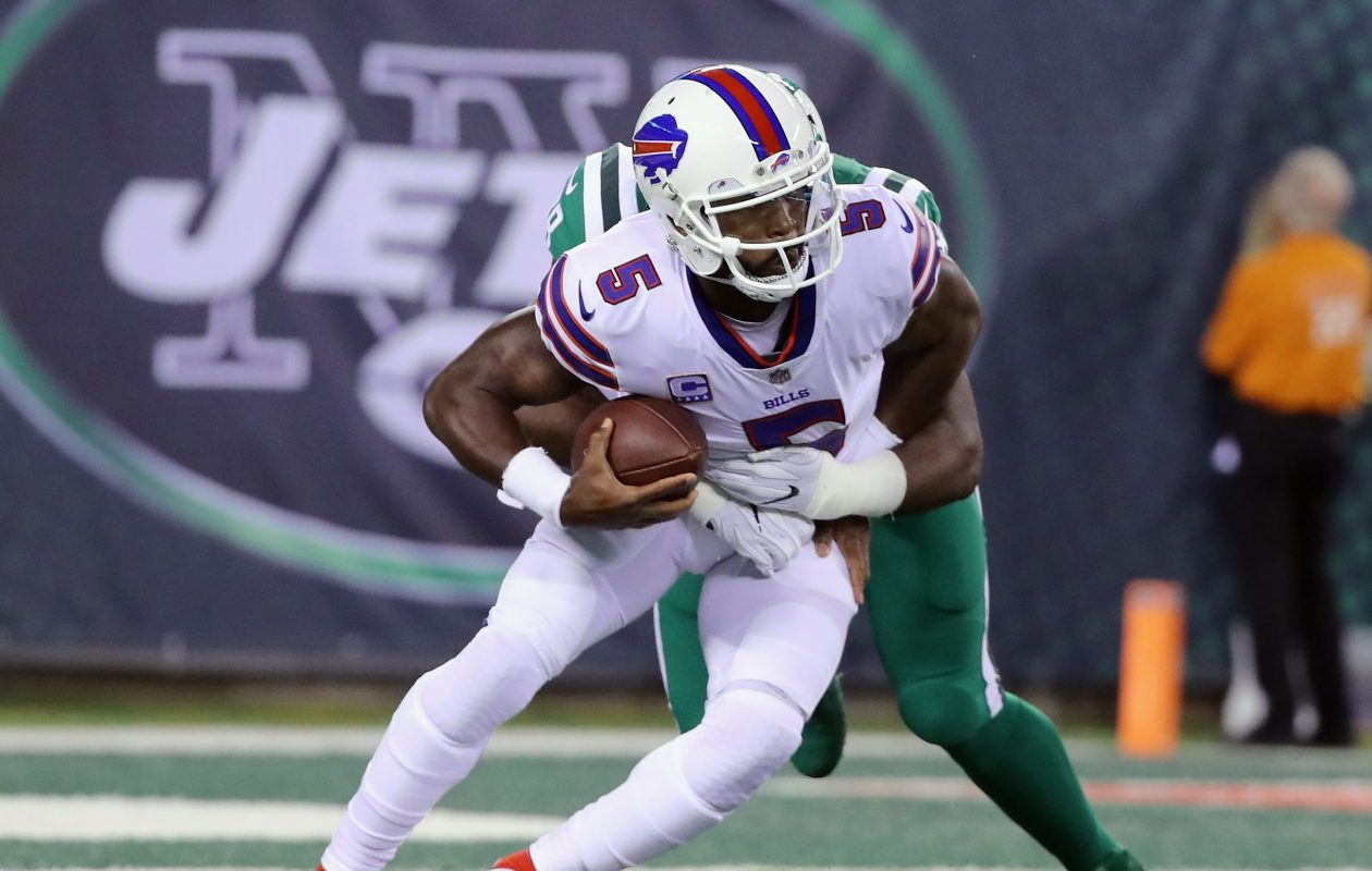 Outside linebacker Jordan Jenkins of the New York Jets sacks Bills quarterback Tyrod Taylor during the first quarter of their game at MetLife Stadium. Taylor was sacked seven times during the game. (Abbie Parr/Getty Images)