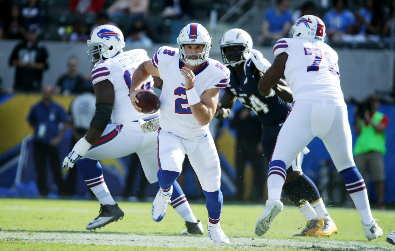 Nathan Peterman of the Buffalo Bills runs with the ball gain extra yardage during first quarter against the Los Angeles Chargers at the StubHub Center on Nov. 19, 2017. (Getty Images)