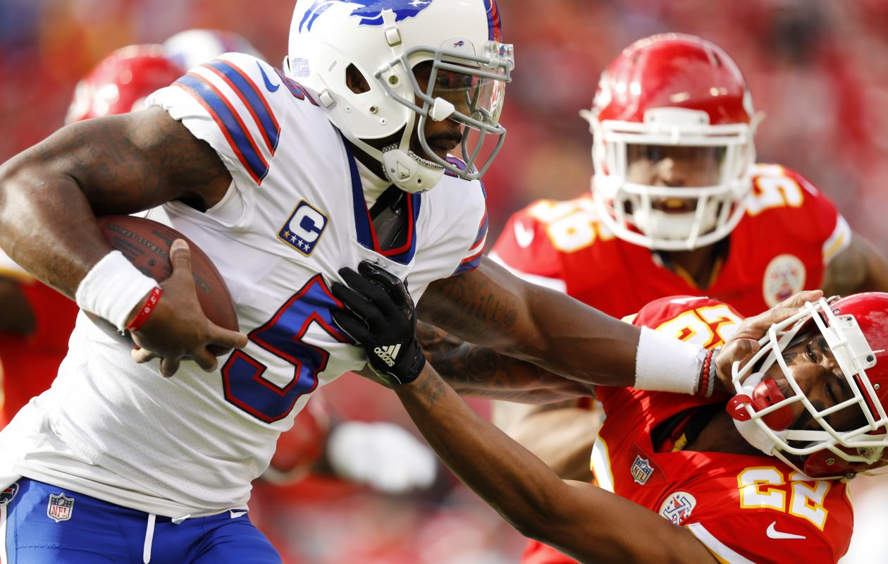 Quarterback Tyrod Taylor (5) of the Buffalo Bills stiff arms cornerback Marcus Peters (22) of the Kansas City Chiefs on a rushing attempt during the first quarter of the game at Arrowhead Stadium on Nov. 26, 2017, in Kansas City, Mo. (Getty Images)