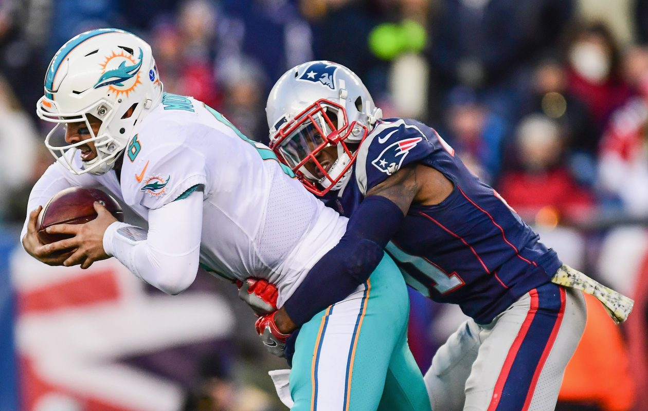 Jonathan Jones of the New England Patriots sacks Matt Moore of the Miami Dolphins. (Adam Glanzman/Getty Images)
