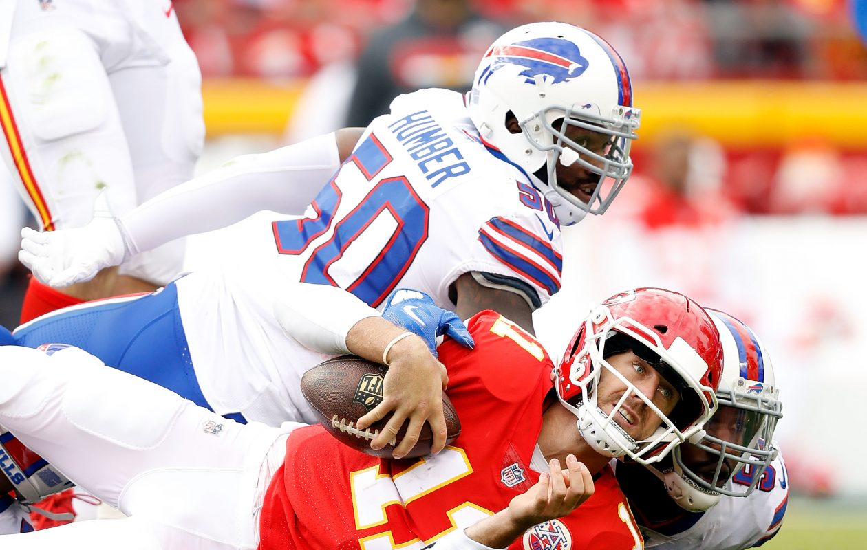 Chiefs quarterback Alex Smith is tackled by Jerry Hughes and Ramon Humber. (Jamie Squire/Getty Images)