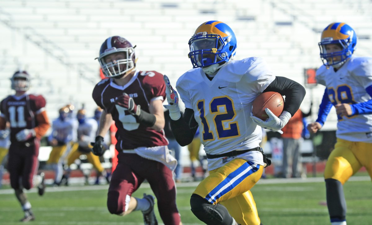 Javon Thomas takes off on a 60-yard touchdown run for Cleve Hill, one of his two long scores during last Saturday's triumph over Caledonia-Mumford/Byron-Bergen in the Far West Regionals at SUNY Brockport. (Harry Scull Jr./Buffalo News)