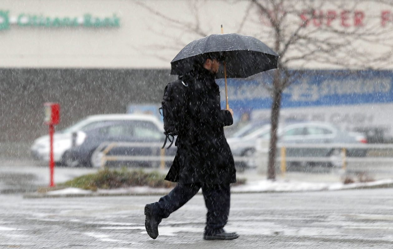 Umbrellas will be necessary today. It's expected to rain for most of the day, but it'll be warm — in the low 50s, forecasters said. (John Hickey/News file photo)