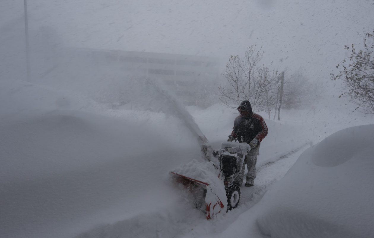 "Mike Kiley, a groundskeeper at Mercy Hospital, engages in typical post-lake effect storm behavior. This was a scene during the infamous ""snowvember"" storm in 2014. (John Hickey/Buffalo News)"
