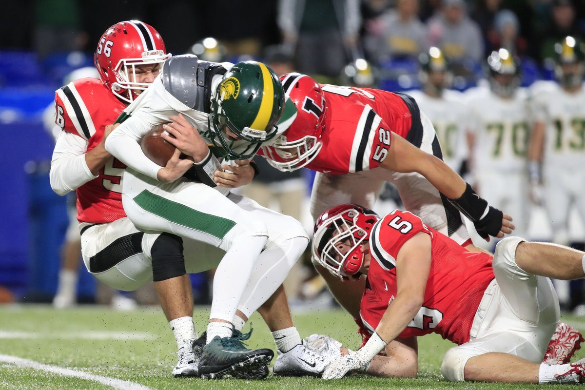 Lancaster's defense gave Williamsville North little room to operate, recording seven sacks during Friday night's Section VI Class AA final. (Harry Scull Jr./Buffalo News)