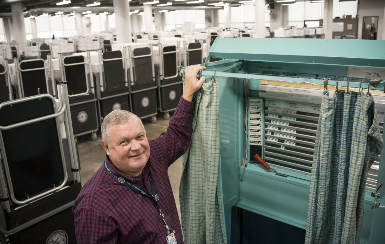 Erie County Elections  Commissioner Ralph Mohr shows off an old lever voting machine in a warehouse at the Tri-Main Center in Buffalo on Wednesday, Nov. 1, 2017.  The lever machines were used by voters until 2010, when the county switched to electronic machines that scan paper ballots. (Derek Gee/Buffalo News)