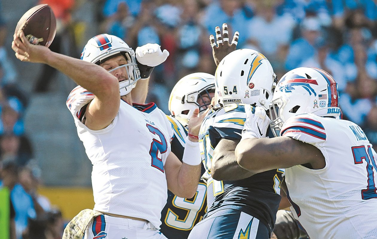 Nathan Peterman's debut as the Bills starting quarterback was a disaster as he was hit multiple times and threw five interceptions against the Los Angeles Chargers. (Harry Scull Jr./ Buffalo News)