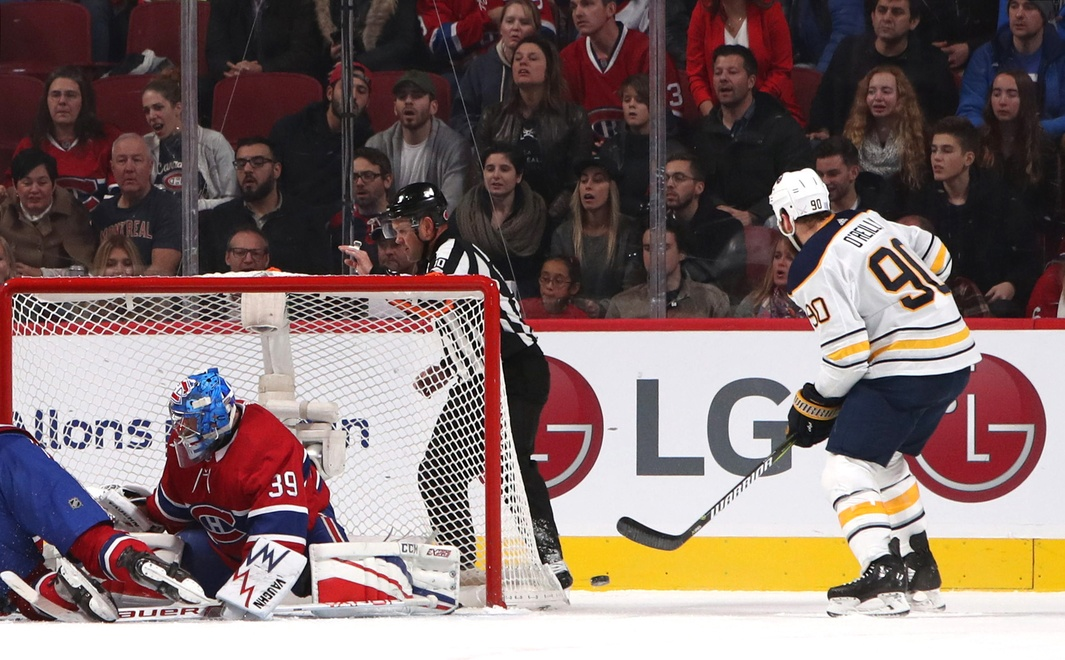 Montreal goaltender Charlie Lindgren, referee Kyle Rehman and Bell Centre fans are all looking the wrong way but Ryan O'Reilly is zoned in on the puck as he prepares to score the game's first goal Saturday night (Jean-Yves Ahern-USA Today Sports)