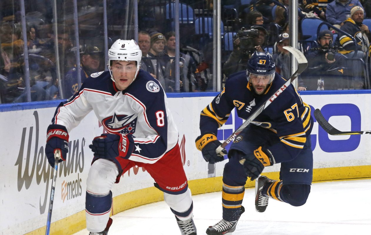 Buffalo's Benoit Pouliot tries to catch up to Columbus' Zach Werenski  behind the net.  (Robert Kirkham/Buffalo News)