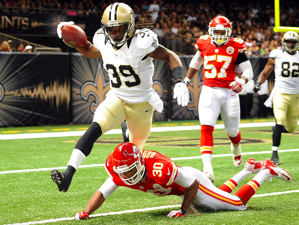 Travaris Cadet hurdles a Chiefs defender during a game with the New Orleans Saints (Getty Images)