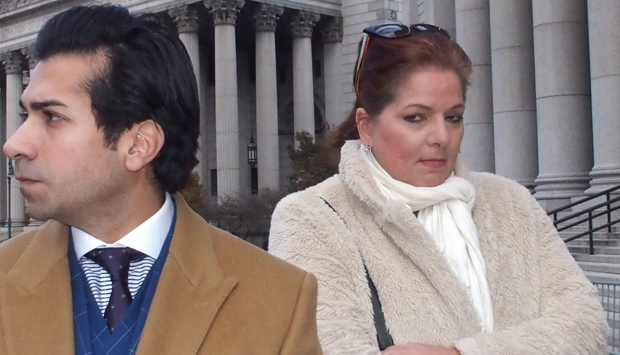 Lisa Marie Cater appeared with her lawyer Paul Liggieri on Sunday in front of the courthouse where she is filing a lawsuit against Sam Hoyt. (Bruce Cotler/special to The News)