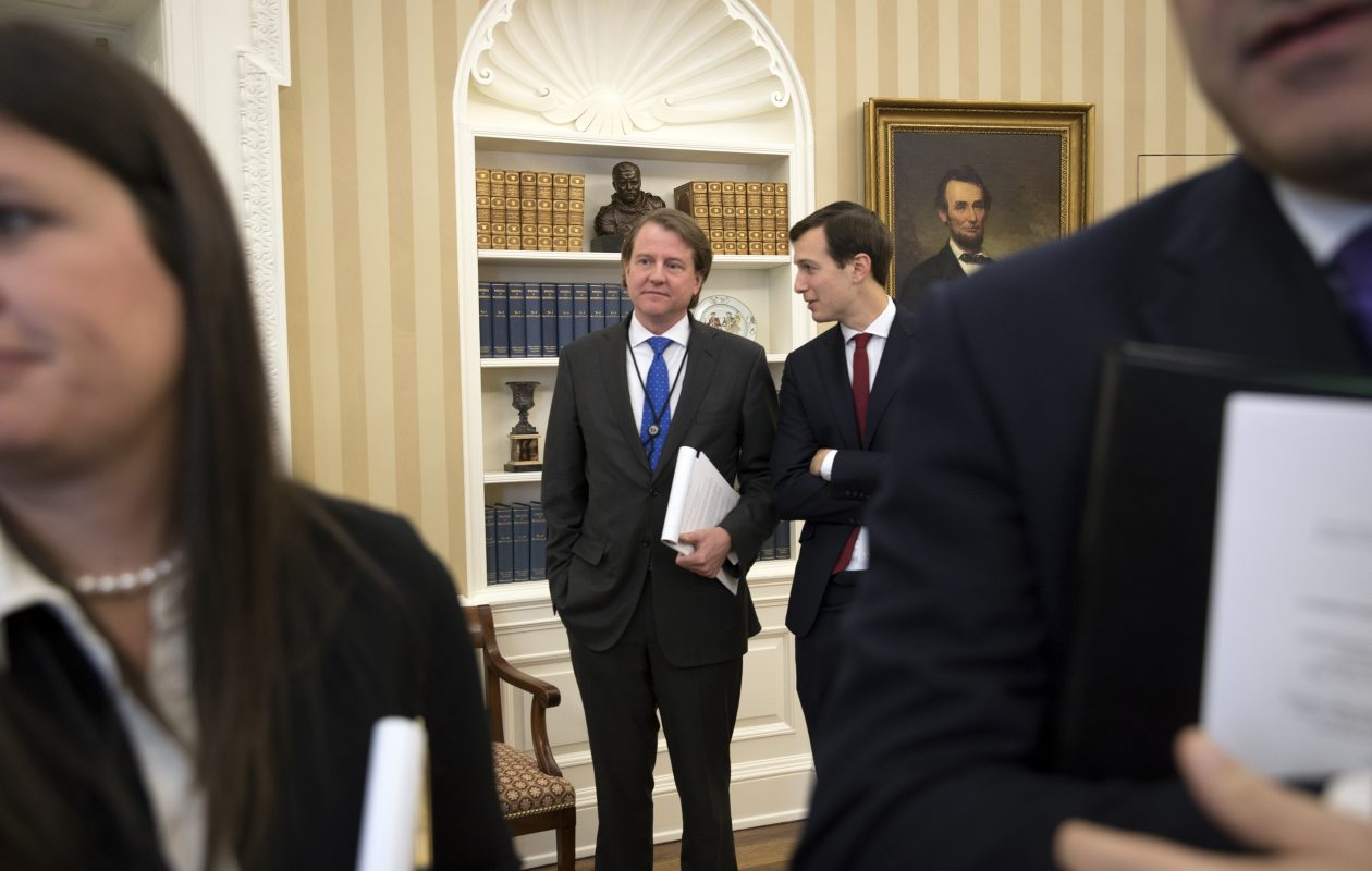 Don McGahn, left, the White House counsel, and Jared Kushner, special adviser to President Donald Trump, in the Oval Office of the White House in Washington, Jan. 30, 2017. McGahn instructed by Trump to maximize the opportunity to reshape the judiciary, organized a secret battle plan to fill the federal appeals courts with young and deeply conservative judges. (New York Times)