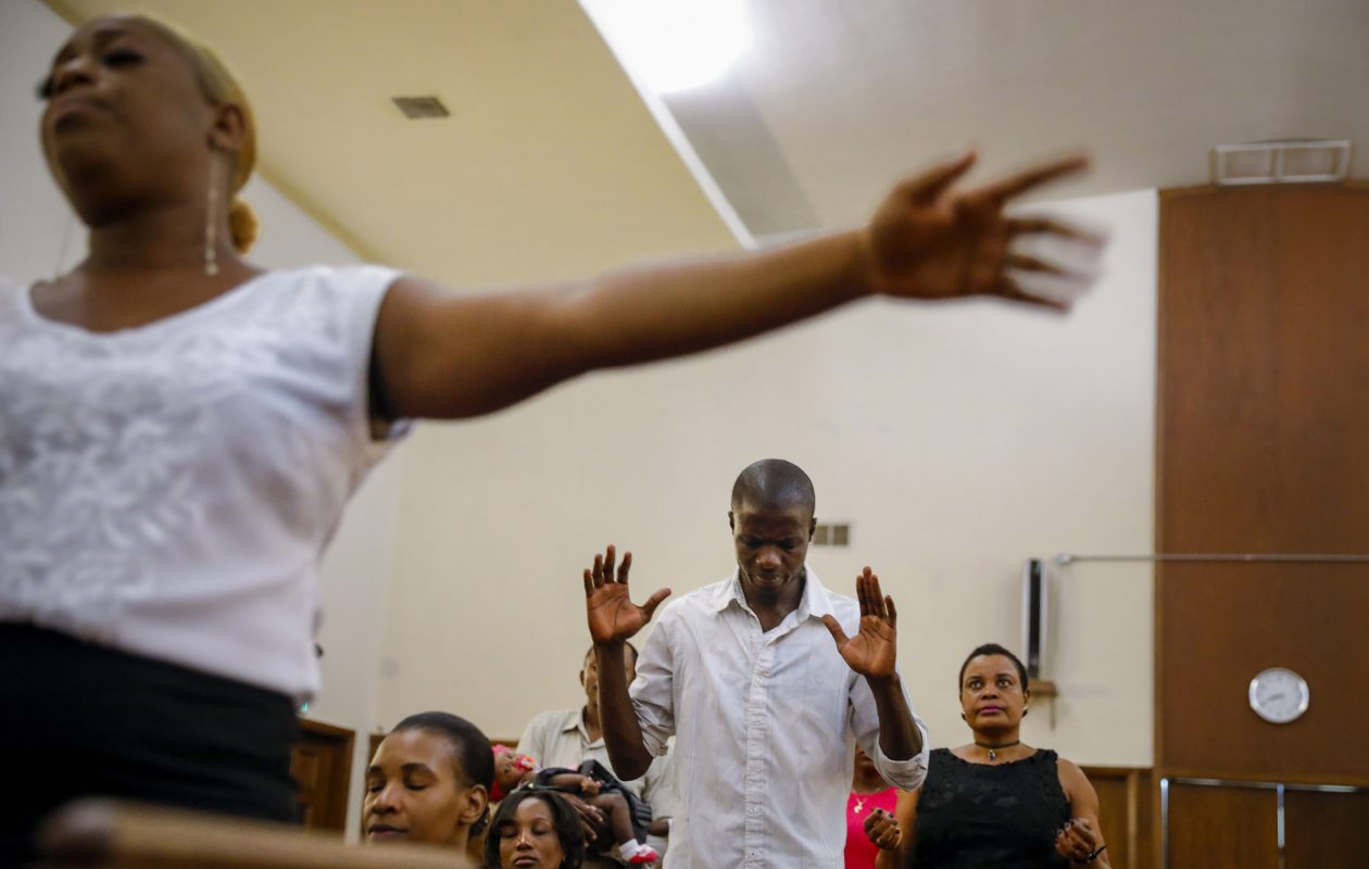 Haitian worshippers during a service on August 13, 2017, at Christ United Methodist Church, in San Diego. Temporary Protected Status, which expires in July 2019, will be revoked for at least 50,000 Haitians living and working across the U.S., leaving Haitians living in the U.S. under TPS an 18-month window to return to their struggling homeland or legalize their status in the U.S. (Jay L. Clendenin/Los Angeles Times/TNS)