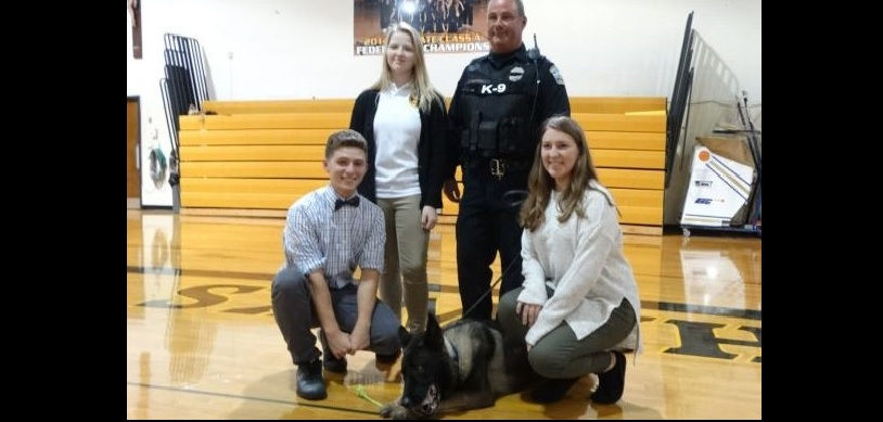 K-9 Shield comes to Cardinal O'Hara High School. Students (l-r)  Kal Klis, Allyson Nemeth and Alyssa Kolcz , present a $1,000 check to  ATF Agent Gerry O'Sullivan and Shield to honor Buffalo  K-9 Officer Craig Lehner.