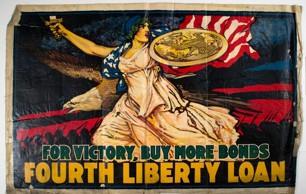 A poster encouraging private donations to the World War I effort is on view in the Central Library as part of a two-year exhibition marking the 100th anniversary of the United States' entry into the war in 1917. (Courtesy of the Buffalo and Erie County Public Libraries)