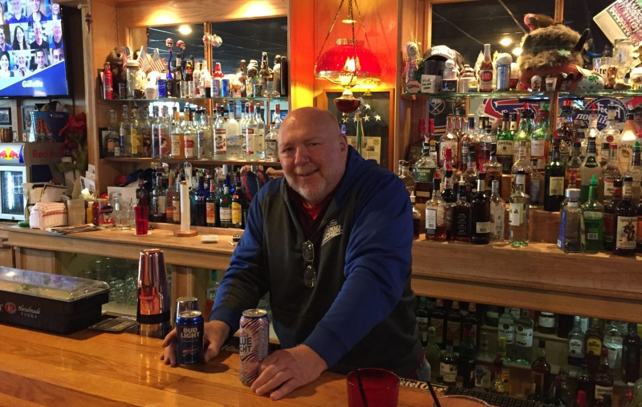 Western New York native Al Burns behind the bar of Al's Bar and Grill in Parkville, Mo.