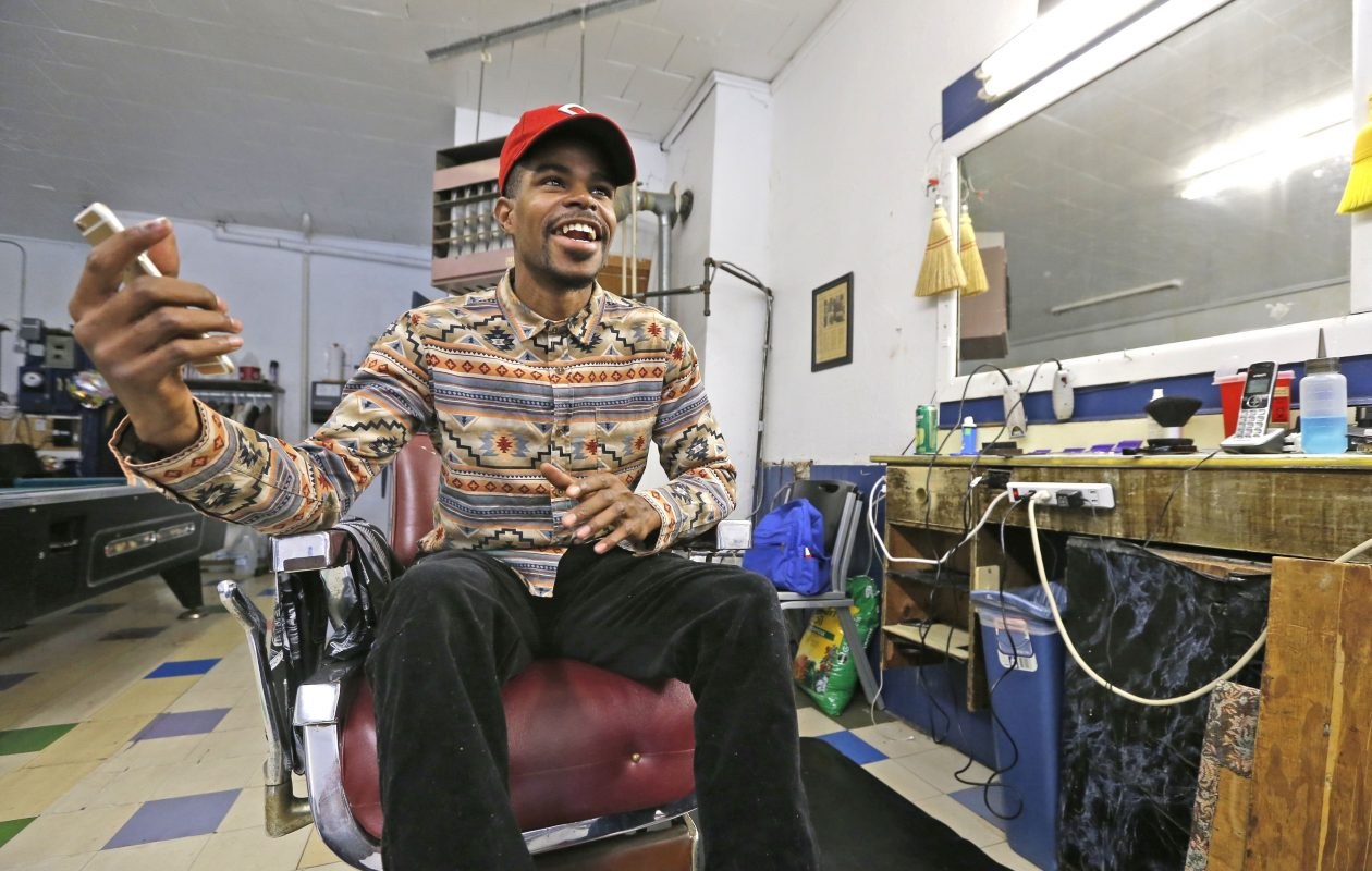 "Barber Larry Kennedy-King, on his first day at the Carl-Jeff  Barber Shop on Jefferson Avenue. On Election Day, he hoped for the same ""miracle"" for others he found for himself. (Robert Kirkham/Buffalo News)"