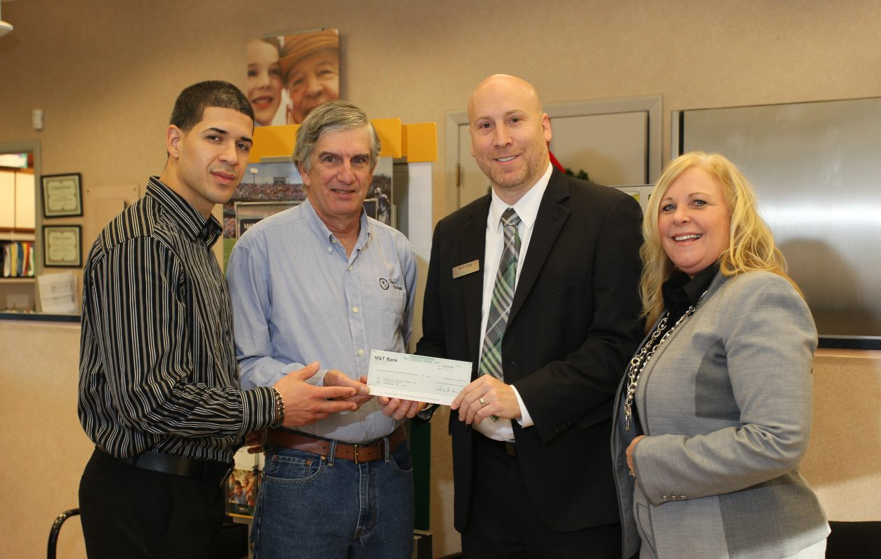 Joalexis Martir of Community Helping Hands, Jim Holler, owner of Trinity Guitars; Rich Grey, branch manager for M&T Bank in Jamestown; and Christine Tarbrake, administrative vice president and Southern Tier regional sales manager. (provided photo)