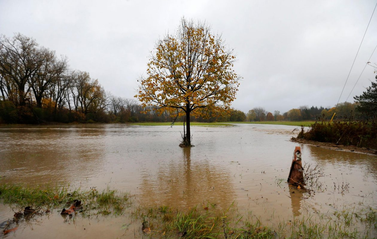 Buffalo Creek overflows its banks on Borden Road in West Seneca Monday. (Mark Mulville/Buffalo News)