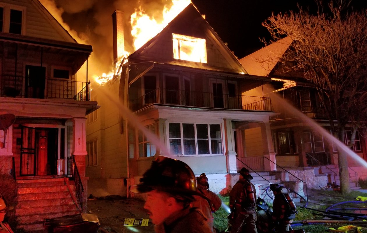 Buffalo firefighters battled a 2-alarm blaze early Tuesday morning at 218 E. Delavan Ave. The fire spread to two neighboring houses and left seven people without a home. (David F. Kazmierczak/Special to the News)