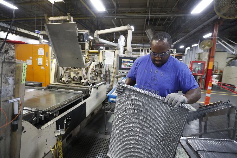 Charles Shellman inspects a radiator he is making at the GM Lockport plant on Monday, Oct. 30, 2017. (Mark Mulville/Buffalo News)