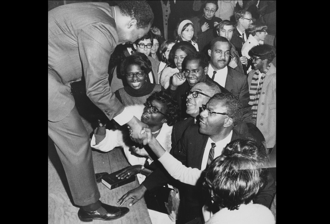 Dr. Martin Luther King Jr. greets members of the community, Nov. 9, 1967, Kleinhans Music Hall; note the Bible at his feet. (Robert L. Smith/The Buffalo News, courtesy of Buffalo History Museum)