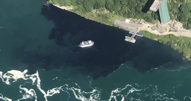 The black discharge from the Niagara Falls Waste Water Treatment Plant engulfed the Maid of the Mist docks on July 29.(Courtesy of Rainbow Air Inc.)