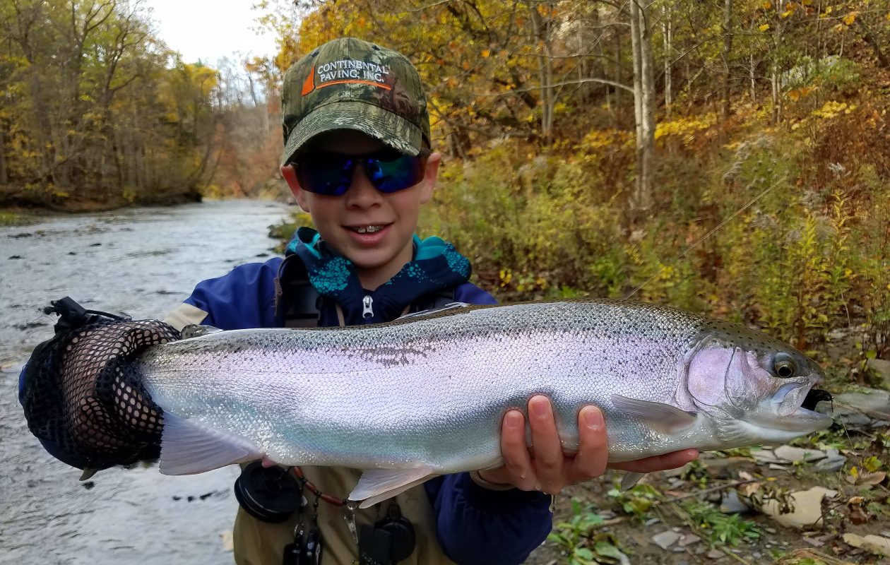 Nick Falcone, 13, of Hamburg, caught his very first steelhead using a 7 weight fly rod, floating line, a flourocarbon leader and a black wooly bugger with an orange hot bead.