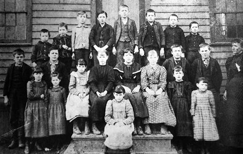 This circa-1888 photo of a class led by instructor Ida Zimmerman was taken in front of the old School House #4 located at the northern end of Delaware Road.