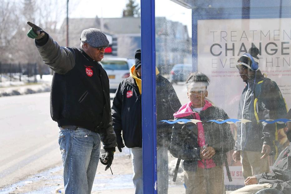 Member of the Buffalo Peacemakers, a coalition of anti-violence groups, keep things calm at East Delevan Avenue and Grider Street as school lets out. (Derek Gee/Buffalo News file photo)