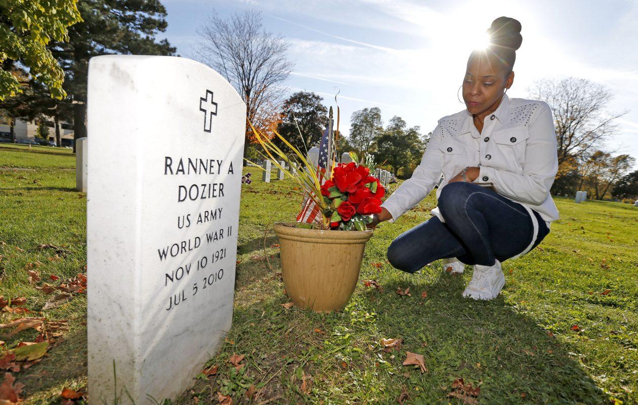 Deidra Patterson last month, at the grave of Ranney Dozier, Forest Lawn Cemetery. (Robert Kirkham/Buffalo News)