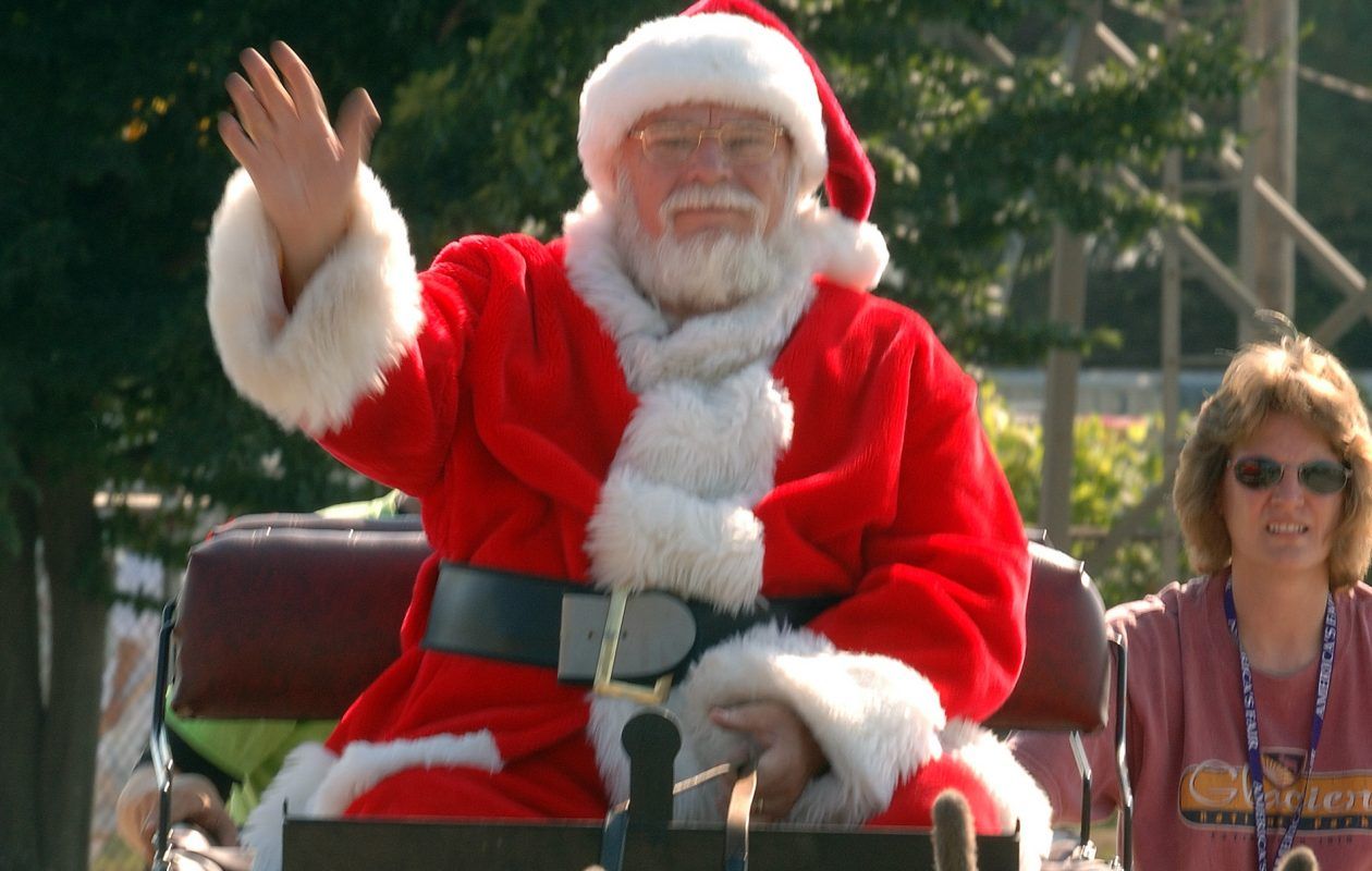 Santa Claus waves during a parade at the Erie County Fair in Hamburg. (News file photo)