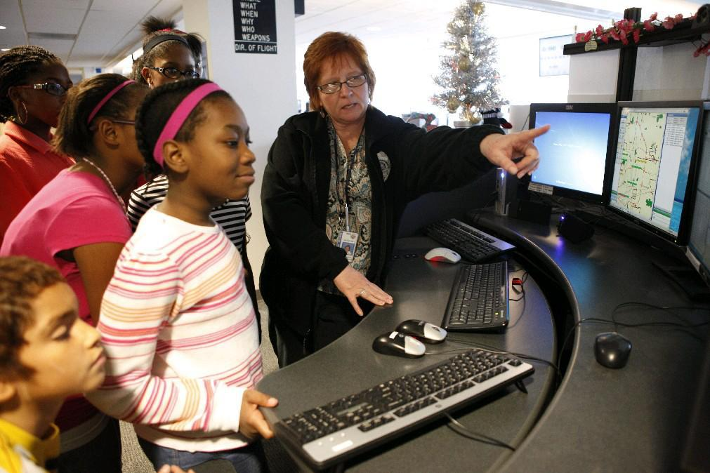 Students in the Success Looks Like Me program get exposed to careers they might never have considered – as in this trip to the county's 911 Communications Center – a well as to minority and women professionals who help them see what is possible for them. (Derek Gee/Buffalo News file photo)